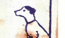 Le chien du boucher, son panier ce trouve à côté de la cheminée